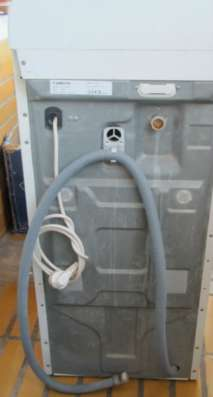 стиральную машину Ariston AT 104 EX