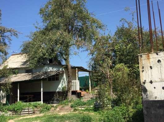 Продам участок 12 сот. с домиком и начатым большим домом