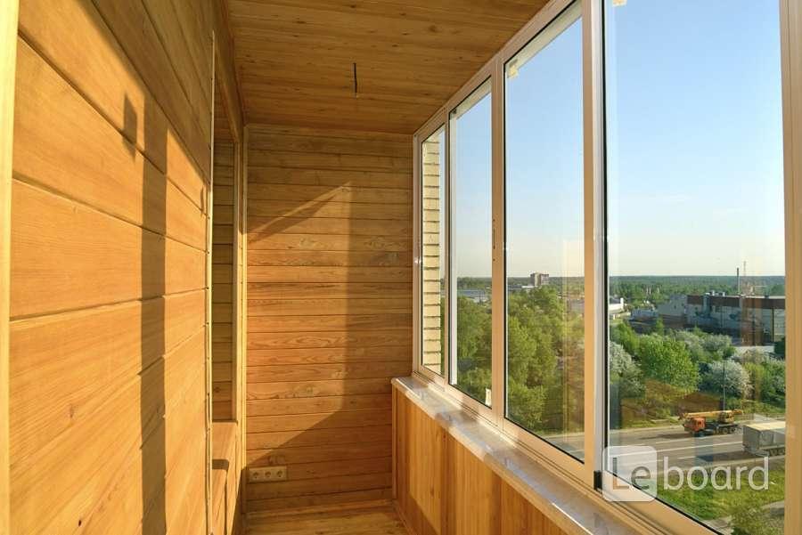 Отделка 6 м балкона деревянной вагонкой в москве.